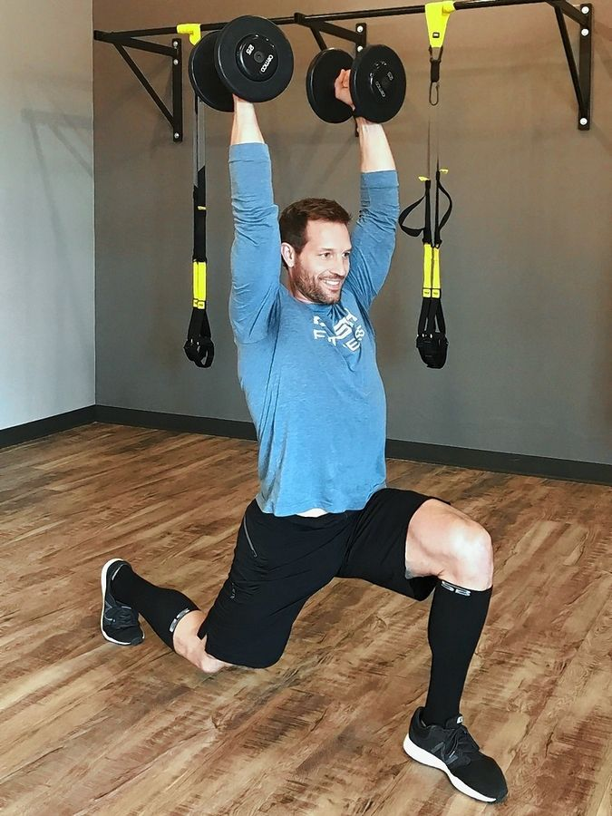 Doing the dumbbell press from a lunge position adds creativity and challenge to a basic exercise.