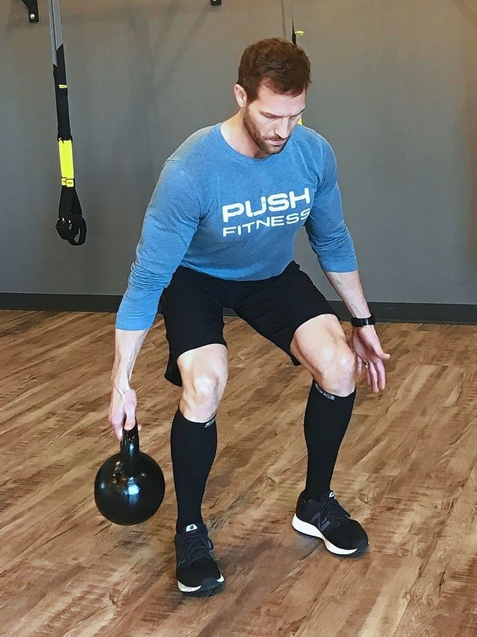 The uneven load of the suitcase deadlift challenges your muscles and builds balance.