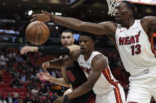Chicago Bulls guard Zach LaVine (8), Miami Heat forward Jimmy Butler, center, and center Bam Adebayo (13) go for the ball during the first half of an NBA basketball game, Sunday, Dec. 8, 2019, in Miami.