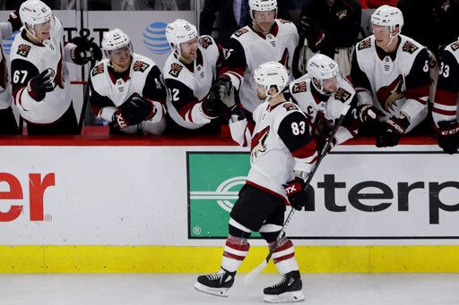 Arizona Coyotes right wing Conor Garland (83) celebrates with teammates after scoring a goal in a shootout of an NHL hockey game against the Chicago Blackhawks Sunday, Dec. 8, 2019, in Chicago. The Coyotes defeated the Blackhawks 4-3.