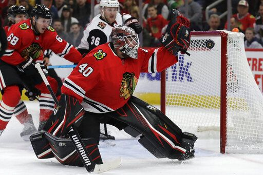 Chicago Blackhawks goalie Robin Lehner blocks a shot by Arizona Coyotes center Christian Dvorak during the first period of an NHL hockey game Sunday, Dec. 8, 2019, in Chicago.