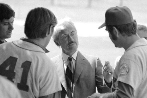 FILE - This March 11, 1972, file photo shows Marvin Miller, executive director of the Major League Players Association, talking to New York Mets' Tom Seaver (41), and Ed Kranepool, in St. Petersburg, Fla. Miller, the union leader who revolutionized baseball by empowering players to negotiate multimillion-dollar contracts and to play for teams of their own choosing, was elected to baseball's Hall of Fame on Sunday, Dec. 8, 2019.