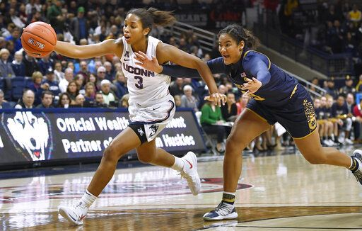 Connecticut's Megan Walker, left, is pursued by Notre Dame's Anaya Peoples in the second half of an NCAA college basketball game, Sunday, Dec. 8, 2019, in Storrs, Conn.