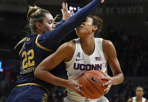 Notre Dame's Danielle Cosgrove, left, fouls Connecticut's Olivia Nelson-Ododa in the second half of an NCAA college basketball game, Sunday, Dec. 8, 2019, in Storrs, Conn.