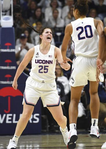 Connecticut's Kyla Irwin (25) and Connecticut's Olivia Nelson-Ododa (20) celebrate in the first half of an NCAA college basketball game against Notre Dame, Sunday, Dec. 8, 2019, in Storrs, Conn.
