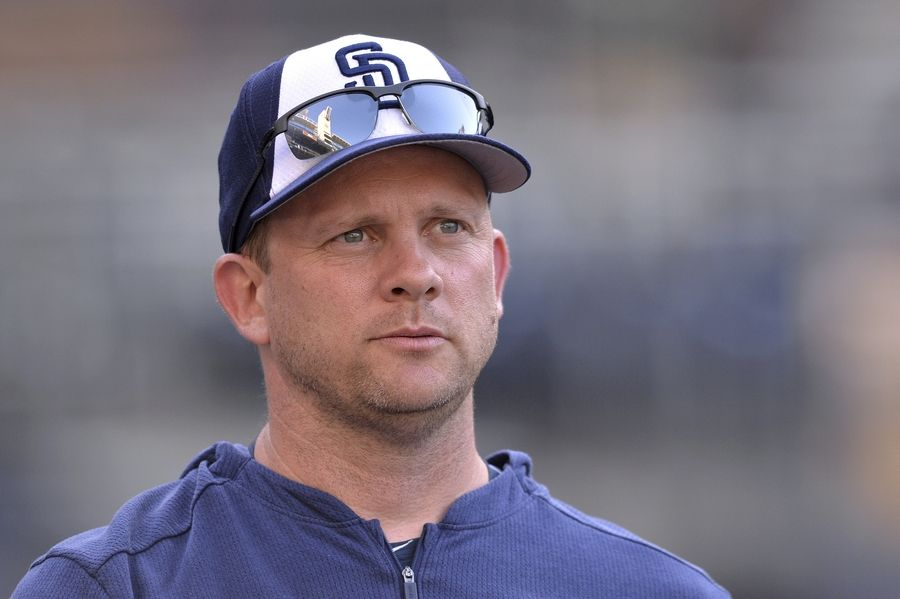 Then-Padres manager Andy Green looks on before a baseball game against the Boston Red Sox on Aug. 23 in San Diego. The Cubs hired Green as bench coach Monday, Dec. 9, 2019.