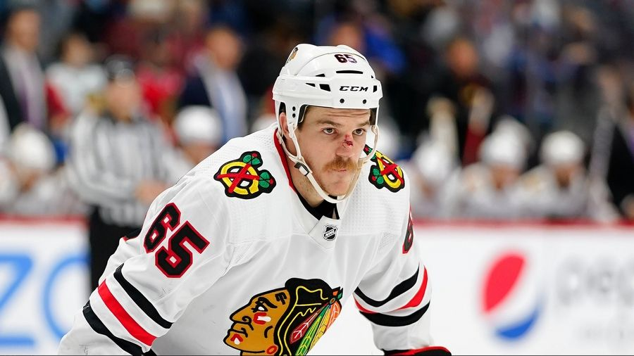 Blackhawks center Andrew Shaw, looks on before a face off against the Colorado Avalanche on Saturday, Nov. 30, 2019, in Denver. Shaw, who is on the concussion protocol, has been placed on long-term injured reserve and can't return to the ice until Dec. 27.