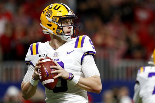 LSU quarterback Joe Burrow (9) looks to pass against Georgia during an NCAA college football game for the Southeastern Conference championship Saturday, Dec. 7, 2019, in Atlanta, Ga. (C.B. Schmelter/Chattanooga Times Free Press via AP)