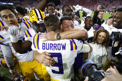 LSU head coach Ed Orgeron embraces quarterback Joe Burrow (9) after defeating Alabama 46-41 in an NCAA college football game, Saturday, Nov. 9, 2019, in Tuscaloosa, Ala.