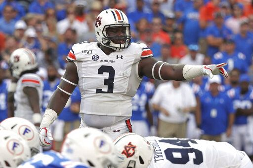 FILE - In this Oct. 5, 2019, file photo, Auburn defensive end Marlon Davidson (3) signals to teammates before a play during the first half of an NCAA college football game against Florida, in Gainesville, Fla. Davidson was selected to The Associated Press All-Southeastern Conference football team, Monday, Dec. 9, 2019.