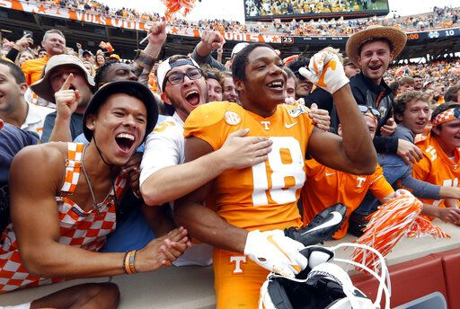 FILE - In this Oct. 12, 2019, file photo, Tennessee defensive back Nigel Warrior (18) celebrates their 20-10 win over Mississippi State in an NCAA college football game, in Knoxville, Tenn. Warrior was selected to The Associated Press All-Southeastern Conference football team, Monday, Dec. 9, 2019.