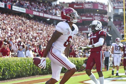 FILE - In this Sept. 14, 2019, file photo, Alabama's DeVonta Smith reacts after scoring a touchdown during the first half of an NCAA college football game against South Carolina, in Columbia, S.C. Smith was selected to The Associated Press All-Southeastern Conference football team, Monday, Dec. 9, 2019.