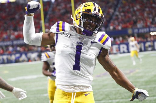 FILE - In this Dec. 7, 2019, file photo, LSU wide receiver Ja'Marr Chase (1) celebrates his touchdown against Georgia during the first half of the Southeastern Conference championship NCAA college football game, in Atlanta. Ja'Marr Chase  was one of three players from LSU's high-powered offense to earn unanimous first-team all-SEC honors when The Associated Press All-Southeastern Conference football team was announced Monday, Dec. 9, 2019.