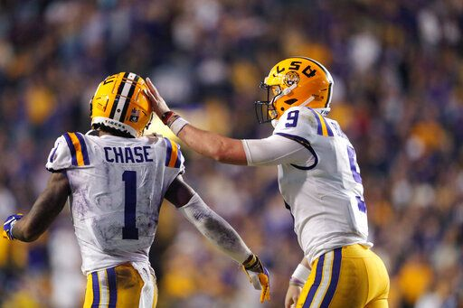 LSU quarterback Joe Burrow (9) celebrates with wide receiver Ja'Marr Chase (1) on their touchdown pass play during the second half of the team's NCAA college football game against Texas A&M in Baton Rouge, La., Saturday, Nov. 30, 2019. LSU won 50-7.