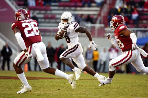 FILE - In this Nov. 2, 2019, file photo, Mississippi State running back Kylin Hill (8) tries to get past Arkansas defenders Micahh Smith (26) and Andrew Parker (28) as he runs for a gain during the second half of an NCAA college football game, in Fayetteville, Ark. Hill was selected to The Associated Press All-Southeastern Conference football team, Monday, Dec. 9, 2019.