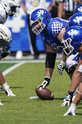 FILE - In this Aug. 31, 2019, file photo, Kentucky center Drake Jackson (52) calls out instructions to teammates during the second half of the NCAA college football game against Toledo, in Lexington, Ky. Jackson was selected to The Associated Press All-Southeastern Conference football team, Monday, Dec. 9, 2019.