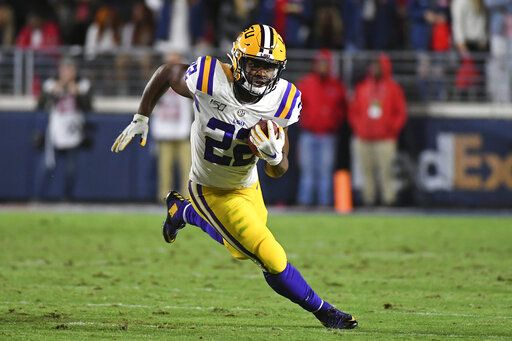FILE - In this Nov. 16, 2019, file photo, LSU running back Clyde Edwards-Helaire (22) runs the ball during the first half of an NCAA college football game against Mississippi, in Oxford, Miss. Clyde Edwards-Helaire was one of three players from LSU's high-powered offense to earn unanimous first-team all-SEC honors when The Associated Press All-Southeastern Conference football team was announced Monday, Dec. 9, 2019.