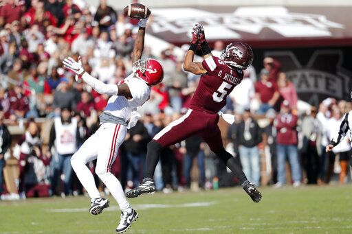 FILE - In this Nov. 16,2019, file photo, Alabama defensive back Trevon Diggs (7), left,  knocks away a pass to Mississippi State wide receiver Osirus Mitchell (5) during the first half of an NCAA college football game, in Starkville, Miss. Diggs was selected to The Associated Press All-Southeastern Conference football team, Monday, Dec. 9, 2019.