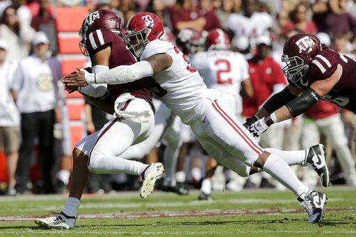 FILE - In this Oct. 12, 2019, file photo, Alabama linebacker Anfernee Jennings (33) tackles Texas A&M quarterback Kellen Mond (11) for a loss during the first quarter of an NCAA college football game, in College Station, Texas. Jennings was selected to The Associated Press All-Southeastern Conference football team, Monday, Dec. 9, 2019.