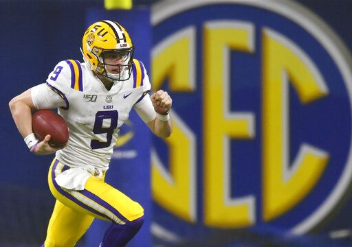 FILE - In this Dec. 7, 2019, file photo, LSU quarterback Joe Burrow (9) runs against Georgia during the second half of the Southeastern Conference championship NCAA college football game, in Atlanta. Burrow is a unanimous selection as the offensive player of the year on The Associated Press All-Southeastern Conference football team, Monday, Dec. 9, 2019.