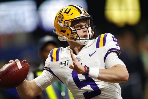 FILE - In this Dec. 7, 2019, file photo, LSU quarterback Joe Burrow (9) warms up before the Southeastern Conference championship NCAA college football game against Georgia, in Atlanta. Burrow is a unanimous selection as the offensive player of the year on The Associated Press All-Southeastern Conference football team, Monday, Dec. 9, 2019.