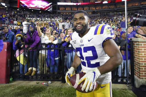 FILE - In this Nov. 9, 2019, file photo, LSU running back Clyde Edwards-Helaire (22) grins after greeting fans following an NCAA football game Saturday against Alabama, in Tuscaloosa, Ala. Clyde Edwards-Helaire was one of three players from LSU's high-powered offense to earn unanimous first-team all-SEC honors when The Associated Press All-Southeastern Conference football team was announced Monday, Dec. 9, 2019.