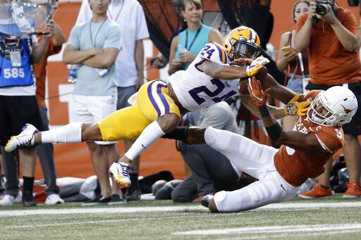 FILE - In this Sept. 7, 2019, file photo, LSU cornerback Derek Stingley Jr., left, breaks up a pass intended for Texas wide receiver Collin Johnson during the first half of an NCAA college football game, in Austin, Texas. Stingley was selected as newcomer of the year on The Associated Press All-Southeastern Conference football team, Monday, Dec. 9, 2019.