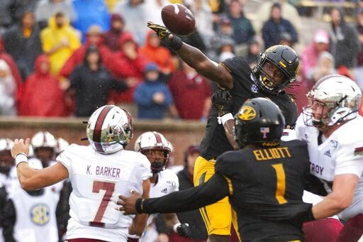 FILE - In this Oct. 5, 2019, file photo, Missouri linebacker Nick Bolton, top right, blocks the pass of Troy quarterback Kaleb Barker, bottom, left, during the first half of an NCAA college football game, in Columbia, Mo. Bolton was selected to The Associated Press All-Southeastern Conference football team, Monday, Dec. 9, 2019.