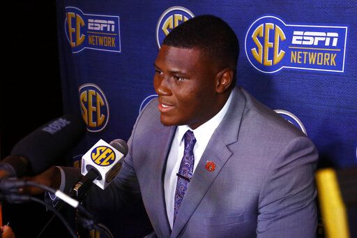 FILE - In this July 18, 2019, file photo, Auburn defensive tackle Derrick Brown speaks to reporters during the NCAA college football Southeastern Conference Media Days, in Hoover, Ala. Brown was selected the SEC defensive player of the year on The Associated Press All-Southeastern Conference football team, Monday, Dec. 9, 2019.