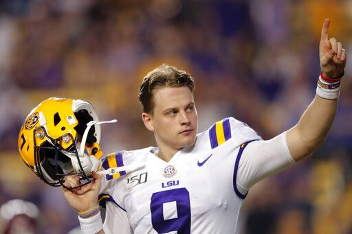 LSU quarterback Joe Burrow, who is considered a frontrunner for the Heisman Trophy, acknowledges the crowd as he is pulled from his last game in Tiger Stadium, in the fourth quarter of the team's NCAA college football game against Texas A&M in Baton Rouge, La., Saturday, Nov. 30, 2019. LSU won 50-7.