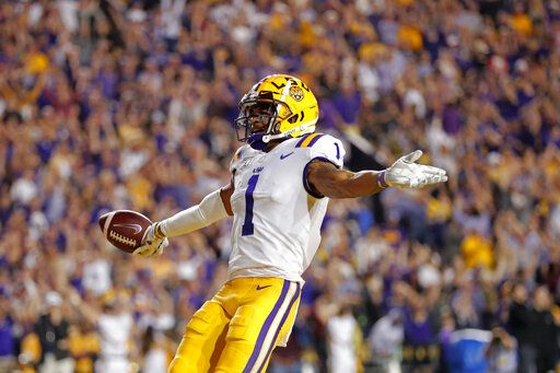 LSU wide receiver Ja'Marr Chase (1) celebrates his touchdown reception during the first half of the team's NCAA college football game against Texas A&M in Baton Rouge, La., Saturday, Nov. 30, 2019.