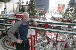 John Busch of Busch Auto Service Center has turned part of his Palatine store into a very large train display for the holidays. Busch figures there is more than 600 feet of track featured in the display.
