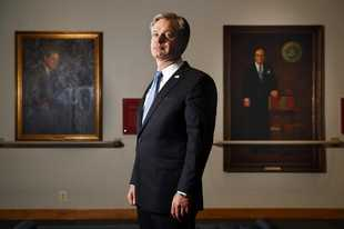 "FBI Director Christopher Wray poses for a photo after an interview with The Associated Press, Monday, Dec. 9, 2019, in Washington. Wray says the problems found by the Justice Department watchdog examining the origins of the Russia probe are 'œunacceptable."" (AP Photo/Jacquelyn Martin)"