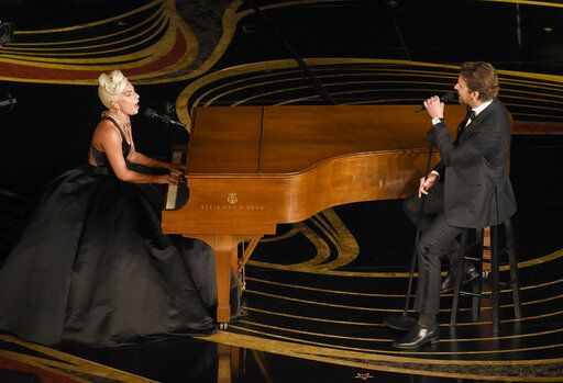 "FILE - This Feb. 24, 2019 file photo shows Lady Gaga, left, and Bradley Cooper performing ""Shallow"" from ""A Star is Born"" at the Oscars in Los Angeles. (Photo by Chris Pizzello/Invision/AP, File)"