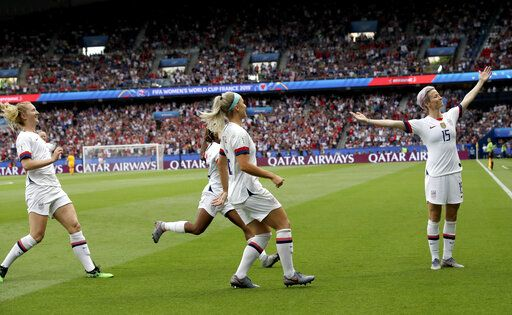 FILE - This June 28, 2019 file photo shows United States' Megan Rapinoe, right, celebrating after scoring her team's first goal during the Women's World Cup quarterfinal soccer match between France and the United States in Paris.
