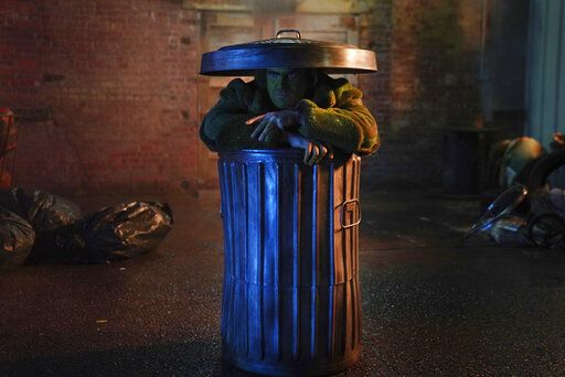 "This image released by NBC shows David Harbour during a parody sketch of the ""Joker"" and Oscar the Grouch of ""Sesame Street"" on ""Saturday Night Live."" (Rosalind O'Connor/NBC via AP)"