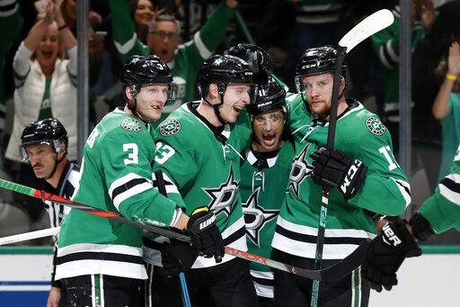 Dallas Stars' John Klingberg (3), Esa Lindell, Andrew Cogliano (11) and Radek Faksa, right, celebrate a goal scored by Lindell in the first period of an NHL hockey game against the Vegas Golden Knights in Dallas, Monday, Nov. 25, 2019.