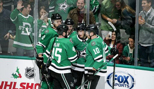 Dallas Stars forward Denis Gurianov, second from right, is congratulated by teammates after scoring a goal during the second period of an NHL hockey game against the Winnipeg Jets on Thursday, Dec. 5, 2019, in Dallas.