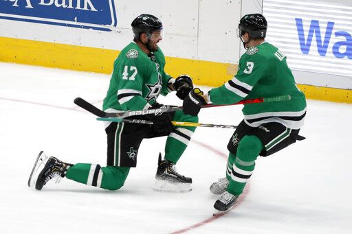 Dallas Stars right wing Alexander Radulov (47) celebrates scoring a goal with defenseman John Klingberg (3) in the third period of an NHL hockey game against the Vegas Golden Knights in Dallas, Monday, Nov. 25, 2019.
