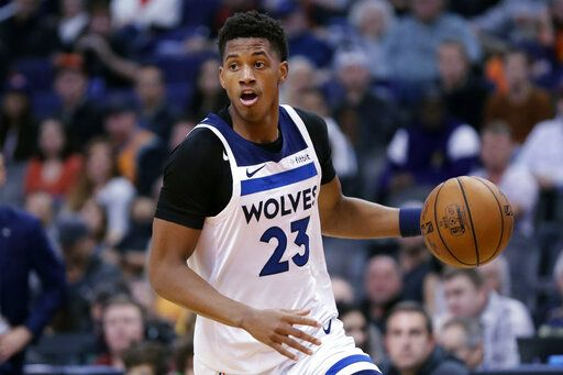 Minnesota Timberwolves guard Jarrett Culver (23) moves the ball up court against the Phoenix Suns during the first half of an NBA basketball game, Monday, Dec. 9, 2019, in Phoenix.