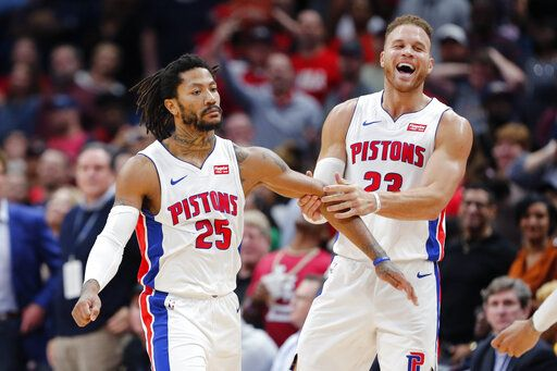 Detroit Pistons guard Derrick Rose (25) celebrates the game winning score with forward Blake Griffin (23) in the second half of an NBA basketball game in New Orleans, Monday, Dec. 9, 2019.