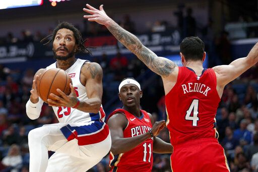 Detroit Pistons guard Derrick Rose (25) goes to the goal as New Orleans Pelicans guard JJ Redick (4) defends in the first half of an NBA basketball game in New Orleans, Monday, Dec. 9, 2019.