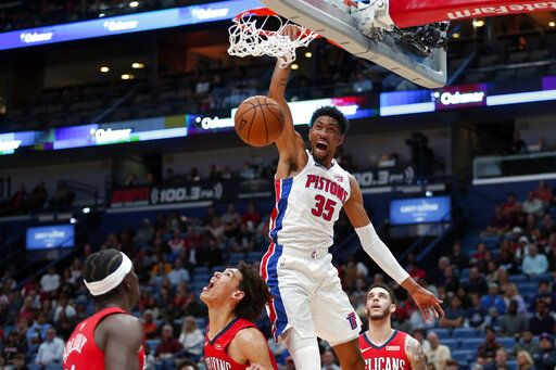 Detroit Pistons forward Christian Wood (35) dunks the ball against the New Orleans Pelicans in the first half of an NBA basketball game in New Orleans, Monday, Dec. 9, 2019.