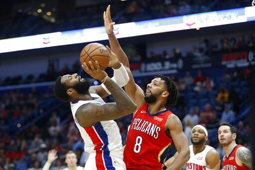 Detroit Pistons center Andre Drummond (0) shoots the ball in front of New Orleans Pelicans center Jahlil Okafor (8) in the first half of an NBA basketball game in New Orleans, Monday, Dec. 9, 2019.