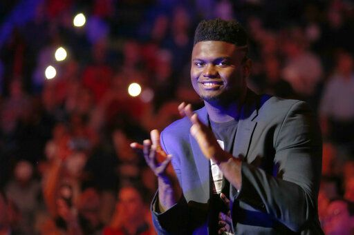 New Orleans Pelicans forward Zion Williamson (1) applauds as the Pelicans are introduced before taking on the Detroit Pistons in an NBA basketball game in New Orleans, Monday, Dec. 9, 2019.
