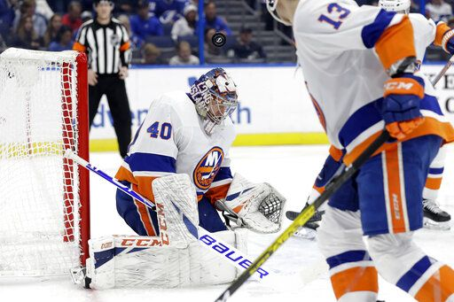 New York Islanders goaltender Semyon Varlamov (40) makes a save on a shot by the Tampa Bay Lightning during the second period of an NHL hockey game Monday, Dec. 9, 2019, in Tampa, Fla.