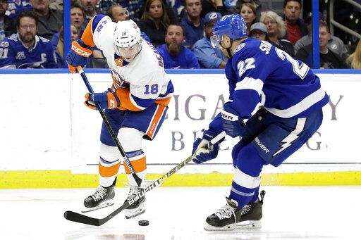 New York Islanders left wing Anthony Beauvillier (18) moves the puck past Tampa Bay Lightning defenseman Kevin Shattenkirk (22) during the third period of an NHL hockey game Monday, Dec. 9, 2019, in Tampa, Fla.