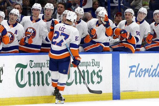New York Islanders left wing Anders Lee (27) celebrates with the bench after scoring against the Tampa Bay Lightning during the third period of an NHL hockey game Monday, Dec. 9, 2019, in Tampa, Fla.