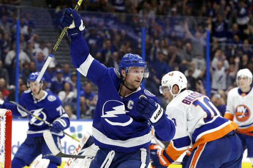 Tampa Bay Lightning center Steven Stamkos (91) celebrates his goal against the New York Islanders during the second period of an NHL hockey game Monday, Dec. 9, 2019, in Tampa, Fla.