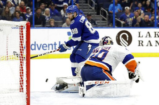 New York Islanders goaltender Semyon Varlamov (40) stops Tampa Bay Lightning center Cory Conacher (89) on a break away during the second period of an NHL hockey game Monday, Dec. 9, 2019, in Tampa, Fla.